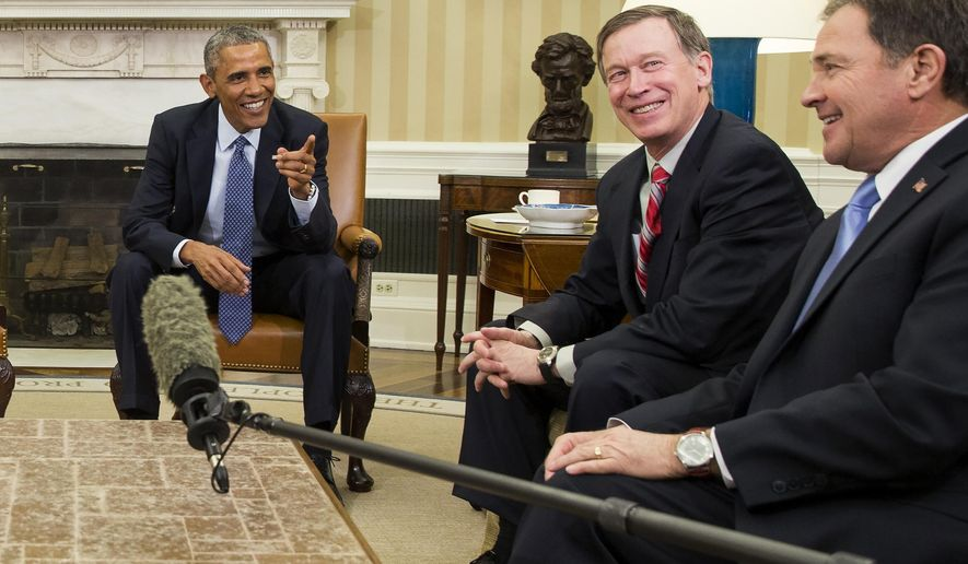 President Barack Obama, left, reacts after National Governors Association Vice Chairman, Utah Gov. Gary Herbert, right, was hit with a microphone during a meeting with the executive committee of the National Governors Association in the Oval Office of the White House in Washington, Tuesday, Jan. 6, 2015. At center is National Governors Association Chairman, Colorado Gov. John Hickenlooper. (AP Photo/Evan Vucci)