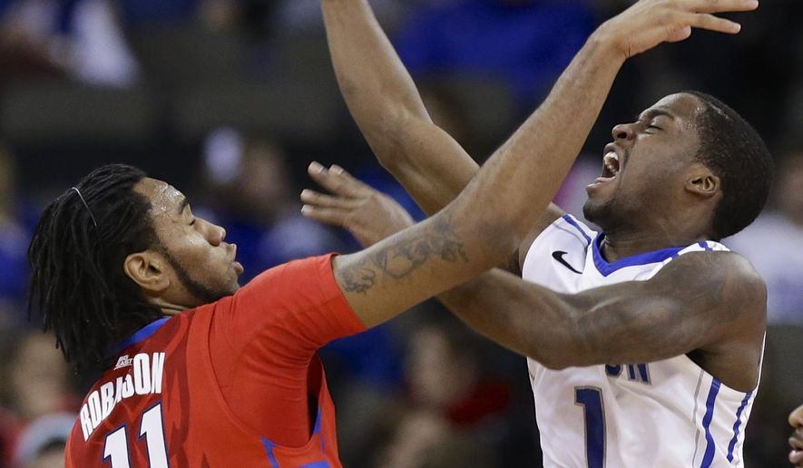 Creighton's Austin Chatman (1) and DePaul's Forrest Robinson (11) compete for a rebound during the first half of an NCAA college basketball game in Omaha, Neb., Wednesday, Jan. 7, 2015. (AP Photo/Nati Harnik)