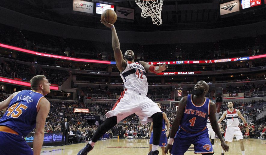 Washington Wizards forward Nene (42), from Brazil, shoots in front of New York Knicks forward Quincy Acy (4) during the first half of an NBA basketball game, Wednesday, Jan. 7, 2015, in Washington. (AP Photo/Alex Brandon)