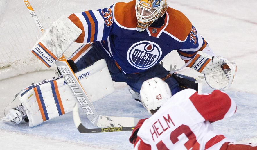 Detroit Red Wings Darren Helm (43) misses the net as Edmonton Oilers goalie Viktor Fasth (35) tries to make the save during second period NHL hockey action in Edmonton, Alberta, on Tuesday Jan. 6, 2015. (AP Photo/The Canadian Press, Jason Franson)