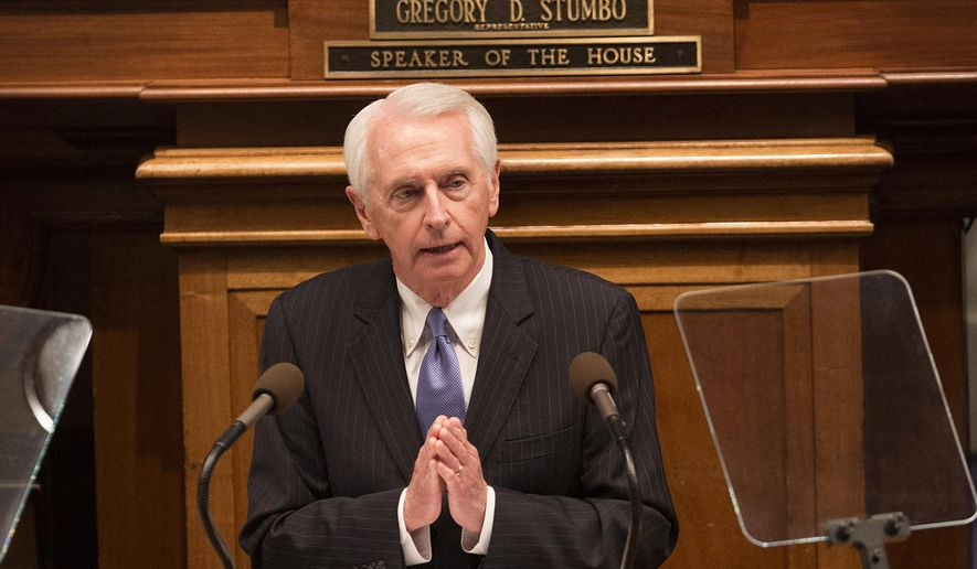 Gov. Steve Beshear delivers his last State of the Commonwealth address of his career during a joint session on the floor of the House of Representatives in Frankfort, Ky., on Wednesday, Jan. 7, 2015. The two-term democratic governor cannot seek re-election due to term limits. Behind him is Republican Senate President Robert Stivers. (AP Photo/David Stephenson)