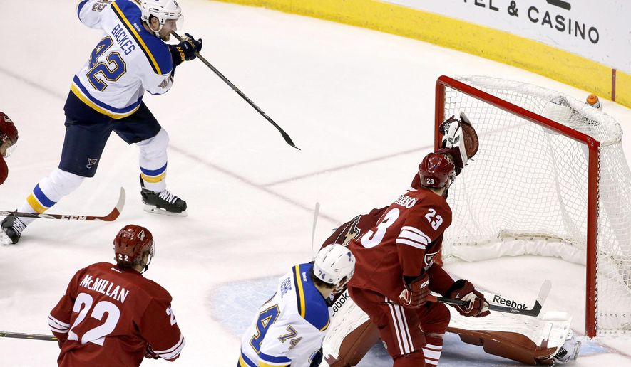 St. Louis Blues' David Backes (42) scores a goal, one of three during the second period, as he sends the puck past Arizona Coyotes' Mike Smith, back right, as Coyotes' Oliver Ekman-Larsson (23), of Sweden, Brandon McMillan (22) and Blues' T.J. Oshie (74) all look on during an NHL hockey game Tuesday, Jan. 6, 2015, in Glendale, Ariz. (AP Photo/Ross D. Franklin)