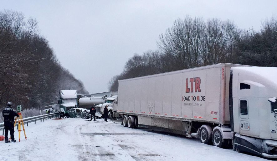 In this photo provided by exploreClarion.com/Bauer Truck Repair, vehicles remain at the scene of a fatal 18-vehicle pileup that occurred in whiteout conditions Wednesday, Jan. 7, 2015, on Interstate 80 near Clarion, Pa. State police said that two people who died were struck after exiting their vehicles at the scene. The victims' identities were not being released until families could be notified. (AP Photo/exploreClarion.com/Bauer Truck Repair)