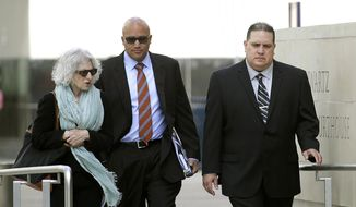 In this photo taken on Nov. 20, 2013, Navy Cmdr. Jose Luis Sanchez, right, walks with unidentified individuals in San Diego, Calif. Sanchez pleaded guilty Tuesday, Jan. 6, 2015, in a massive bribery scheme involving a longtime military contractor in Asia who allegedly offered luxury travel, prostitutes and other bribes to Navy officers in exchange for confidential information. Sanchez, 42, is the highest-ranking official to plead guilty in the case, which rocked the Navy when the first charges were filed in 2013. He faces a maximum penalty of 20 years in prison when he is sentenced March 27.  (AP Photo/U-T San Diego, John Gastaldo )  NO SALES; COMMERCIAL INTERNET OUT
