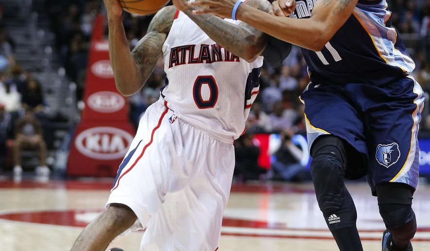 Atlanta Hawks guard Jeff Teague (0) drives against Memphis Grizzlies guard Mike Conley (11) in the second half of an NBA basketball game Wednesday, Jan. 7, 2015, in Atlanta. Atlanta won 96-86. (AP Photo/John Bazemore)