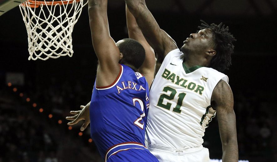 Kansas forward Cliff Alexander (2) has his shot rejected by Baylor's Taurean Prince (21) in the first half of an NCAA college basketball game, Wednesday, Jan. 7, 2015, in Waco, Texas. Kansas' Perry Ellis  bottom left, and Frank Mason III, bottom right watch the play. (AP Photo/Tony Gutierrez)