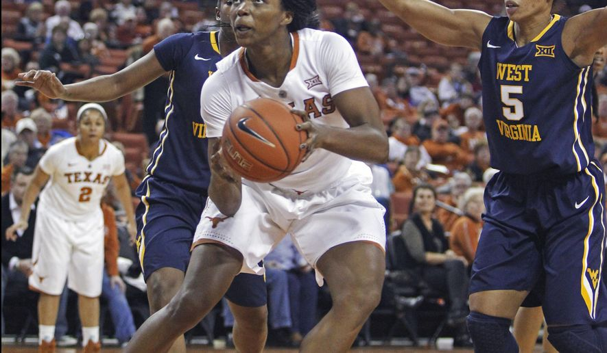 Texas forward Nneka Enemkpali looks to shoot against West Virginia forward Averee Fields, right, during the first half an NCAA college basketball game, Wednesday, Jan. 7, 2015, in Austin, Texas. (AP Photo/Michael Thomas)