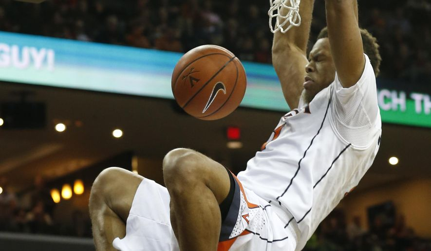 Virginia guard Justin Anderson (1) slams home a dunk during the first half of an NCAA college basketball game in Charlottesville, Va., Wednesday, Jan. 7, 2015.   (AP Photo/Steve Helber)