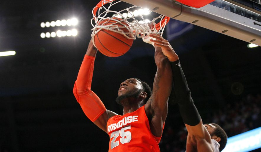 Syracuse forward Rakeem Christmas (25) slam-dunks in the first half of an NCAA college basketball game against Georgia Tech in Atlanta, Wednesday, Jan. 7, 2015. (AP Photo/Todd Kirkland)