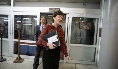 Sen. Susan Collins, Maine Republican, followed by Sen. Brian Schatz, Hawaii Democrat, join other senators in a rush to the Senate floor on Capitol Hill in Washington on Dec. 11, 2014, for a procedural vote to advance the $585 billion defense bill. (Associated Press) **FILE**
