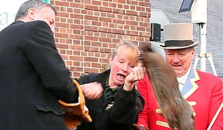 In this Feb. 2, 2014, image made from video, a groundhog breaks free from New York Mayor Bill de Blasio, left, and drops to the stage during the 2014 Groundhog Day ceremony at the Staten Island Zoo, in New York. The groundhog died a week after the fall. (AP Photo/Staten Island Advance, Anthony DePrimo)