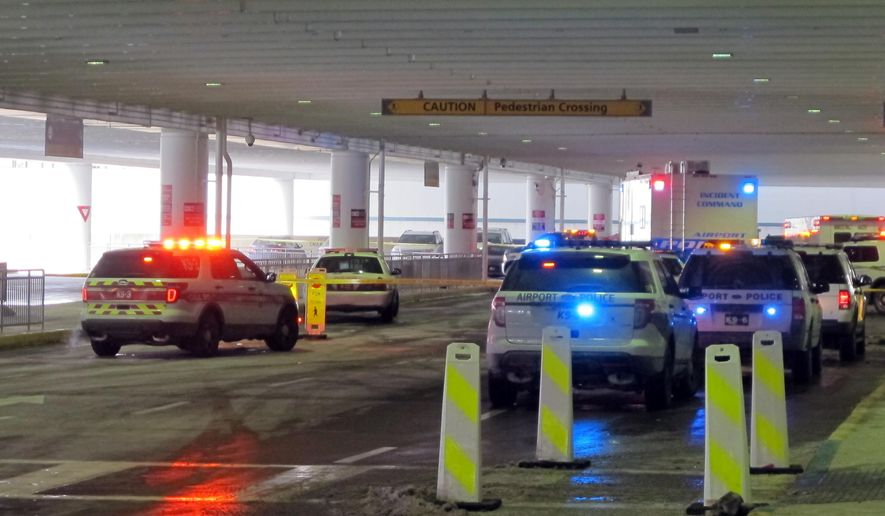 Emergency vehicles converge at the ticketing level at Port Columbus International Airport after officials say an airport police officer shot and killed a man after a confrontation, Wednesday, Jan. 7, 2015, in Columbus, Ohio. Airport spokesman David Whittaker says the officer was not injured and airport operations are normal. (AP Photo/Andrew Welsh-Huggins)