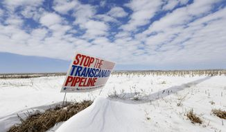 "FILE - In this March 11, 2013 file photo is a sign reading ""Stop the Transcanada Pipeline"" placed in a field near Bradshaw, Neb. Even if the Republican-led Congress approves the Keystone XL pipeline, not a drop of oil will flow through the system until Nebraska signs off on its route. The routing process is still before the state Supreme Court, and depending on how justices rule, it could be months or longer before any construction in Nebraska begins. (AP Photo/Nati Harnik, File)"