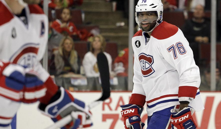 In this photo taken on Dec. 5, 2014, Montreal Canadiens defenseman P.K. Subban (76) looks around as he skates on the ice during the second period of an NHL hockey game against the Chicago Blackhawks in Chicago. Subban's outgoing, over-the-top personality is matched only by his unbridled ability, which have made him a fan-favorite in Montreal, the NHL's highest paid blue-liner and among the league's most talked-about players.  (AP Photo/Nam Y. Huh)