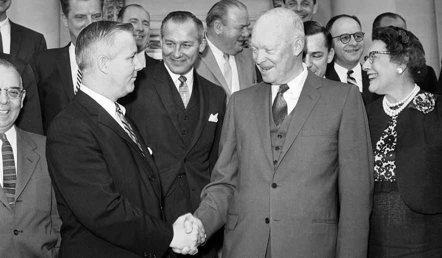 FILE - In this May 12, 1960, file photo, President Dwight Eisenhower, front right, shakes hands with Rep. Arch Moore, of West Virginia, as he poses with a group of Republican congressmen after breakfast at the White House, in Washington. Moore, whose guilty pleas to federal corruption charges overshadowed his record as his era's most successful Republican in Democrat-dominated West Virginia, died Wednesday, Jan. 7, 2015. He was 91. (AP Photo/Bill Allen, File)