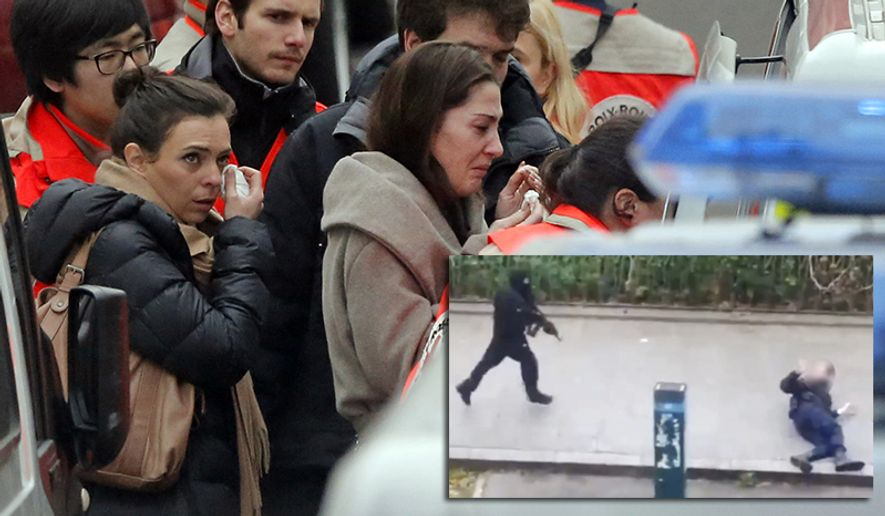 People are evacuated outside the French satirical newspaper Charlie Hebdo's office, in Paris, Wednesday, Jan. 7, 2015. Masked gunmen stormed the offices of a French satirical newspaper Wednesday, killing at least 11 people before escaping, police and a witness said. The weekly has previously drawn condemnation from Muslims.  (AP Photo/Francois Mori)