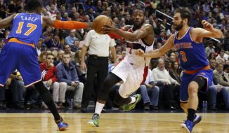 Washington Wizards guard John Wall (2) splits between New York Knicks forward Cleanthony Early (17) and guard Jose Calderon (3), from Spain, during the second half of an NBA basketball game, Wednesday, Jan. 7, 2015, in Washington. The Wizards won 101-91. (AP Photo/Alex Brandon)