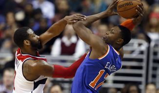 Washington Wizards guard John Wall (2) fouls New York Knicks forward Cleanthony Early (17) during the second half of an NBA basketball game, Wednesday, Jan. 7, 2015, in Washington. The Wizards won 101-91.(AP Photo/Alex Brandon)