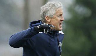 Seattle Seahawks head coach Pete Carroll calls to his team during practice drills Wednesday, Jan. 7, 2015, in Renton, Wash. The Seahawks will play the Carolina Panthers on Saturday in an NFL football divisional playoff game. (AP Photo/Ted S. Warren)