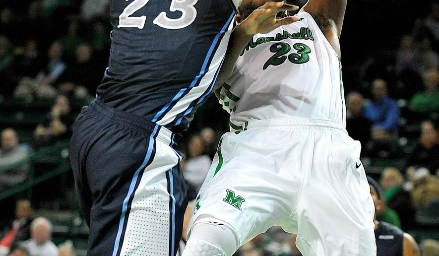 Marshall's Justin Edmonds, right, shoots over Old Domininon's Richard Ross, left, during an NCAA college basketball game in Huntington, W.Va., Thursday, Jan. 8, 2015. (AP Photo/Chris Tilley)
