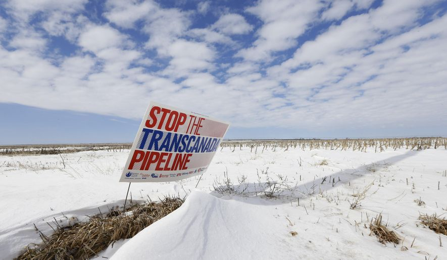 "FILE - In this March 11, 2013, file photo, a sign reading ""Stop the Transcanada Pipeline"" stands in a field near Bradshaw, Neb. A bill to approve the Keystone XL oil pipeline cleared a key Senate committee Thursday, setting up a fight next week pitting newly empowered Republicans against President Barack Obama and Senate Democrats. The Senate Energy and Natural Resources committee moved the bill closer to the floor by a 13-9 vote. Sen Joe Manchin of West Virginia, one of six Democrats sponsoring the bill, was the only Democrat to support it in committee.  The House will vote on its version of the bill Friday, and is expected to pass it easily.  (AP Photo/Nati Harnik, File)"