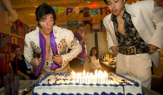 Elvis Presley impersonators Jimi Cochrane, left, of Houston, and Mansour Spears, 15, of Austin, blow out the candles at Elvis' 80th birthday party at Chuy's restaurant in Austin, Texas, Thursday, Jan. 8, 2015. (AP Photo/Austin American-Statesman, Jay Janner)