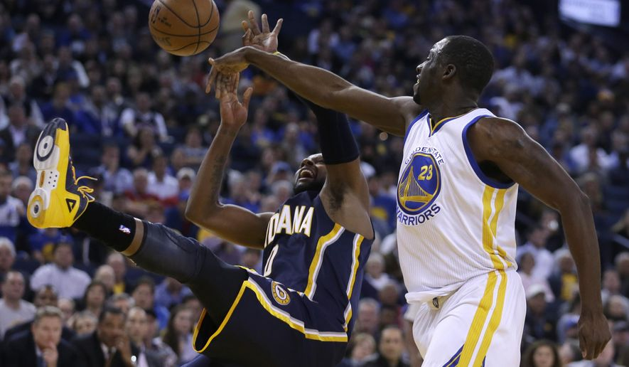 Golden State Warriors' Draymond Green, right, blocks the shot of Indiana Pacers' C.J. Miles during the first half of an NBA basketball game Wednesday, Jan. 7, 2015, in Oakland, Calif. (AP Photo/Ben Margot)