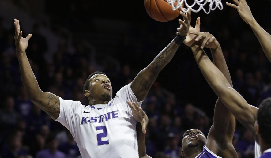 Kansas State guard Marcus Foster (2) rebounds against TCU forward Devonta Abron, right, during the first half of an NCAA college basketball game in Manhattan, Kan., Wednesday, Jan. 7, 2015. (AP Photo/Orlin Wagner)