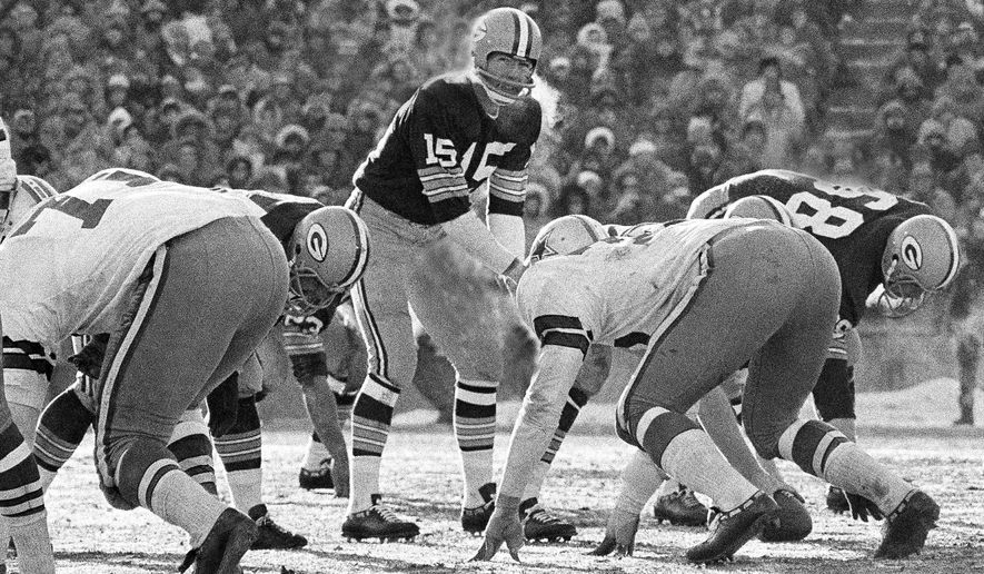 FILE - In this Dec. 31, 1967, file photo, Green Bay Packers quarterback Bart Starr calls signals in bitter cold as he led the Packers to a 21-14 win over the Dallas Cowboys to capture third consecutive National Football League title in Green Bay, Wisc. In the history of NFL games, none stands out for the brutal conditions in which it was played like the NFC championship on the last day of 1967. Simply dubbed the Ice Bowl, those who participated in Cowboys-Packers that day at Lambeau Field still shiver when talking about it. (AP Photo/File)