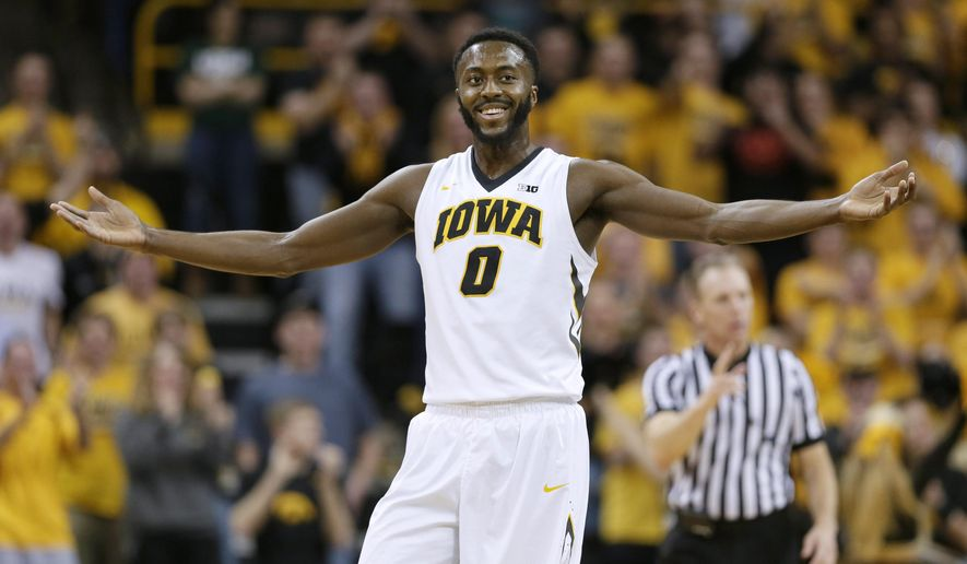 Iowa center Gabriel Olaseni reacts after making a basket during the first half of an NCAA college basketball game against Michigan State, Thursday, Jan. 8, 2015, in Iowa City, Iowa. (AP Photo/Charlie Neibergall)