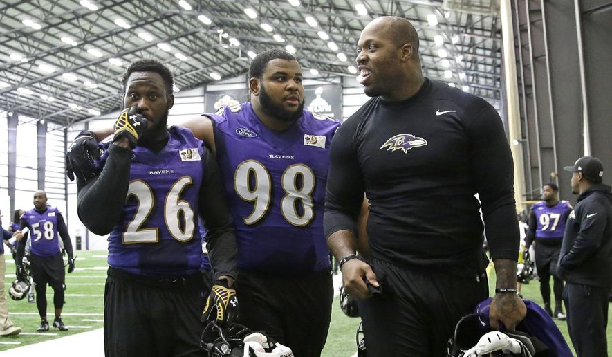 Baltimore Ravens strong safety Matt Elam, from left, nose tackle Brandon Williams and outside linebacker Terrell Suggs walk off the field after an NFL football practice, Wednesday, Jan. 7, 2015, in Owings Mills, Md. The Ravens will travel to New England for a divisional playoff game against the Patriots on Saturday, Jan. 10. (AP  Photo/Patrick Semansky) **FILE**