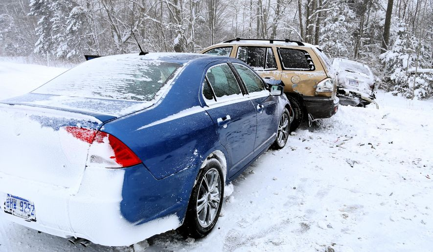 Vehicles involved in a 30-40 car accident rest after colliding going southbound on U.S. 31 north of Russell Road, in Muskegon, Mich, on Wednesday,  Jan. 7, 2015.  (AP Photo/The Muskegon Chronicle, Andraya Croft) ALL LOCAL TELEVISION OUT; LOCAL TELEVISION INTERNET OUT