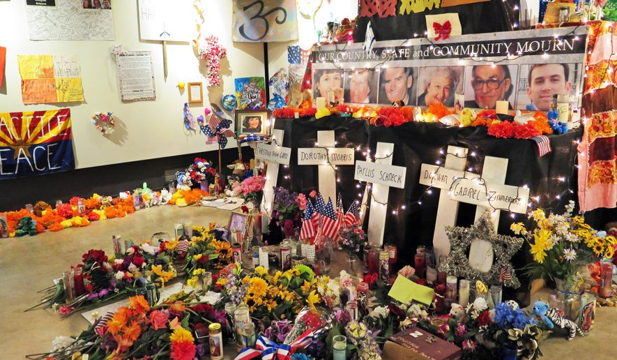 Flowers, teddy bears and inspirational posters line a room at the Arizona History Museum in Tucson in this Wednesday, Jan. 7, 2015 photo. The items were left at the scene of the Jan. 8, 2011, shooting in Tucson that left six dead and 13 wounded. Former Rep. Gabby Giffords was the target and suffered a gunshot wound to the head from which she is still recovering. So many items were left at the shooting site and at University Medical Center, where victims were treated, that a nonprofit group stored them in a warehouse for several years. They have been on display at an exhibit at the museum since October 2014, but will be removed Jan. 9. (Associated Press)