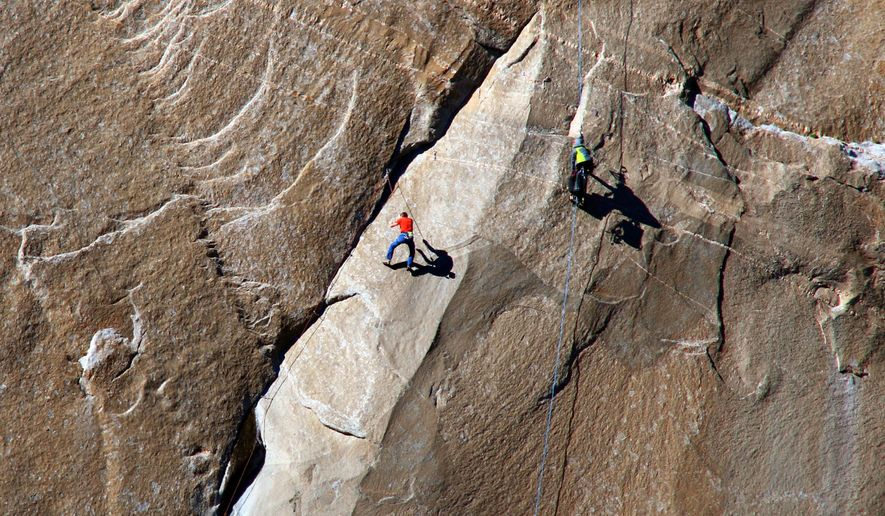 In this Dec. 28, 2014 photo provided by Tom Evans, Tommy Caldwell ascends what is known as pitch 10 on what has been called the hardest rock climb in the world: a free climb of a El Capitan, the largest monolith of granite in the world, a half-mile section of exposed granite in California's Yosemite National Park. (AP Photo/Tom Evans, elcapreport)