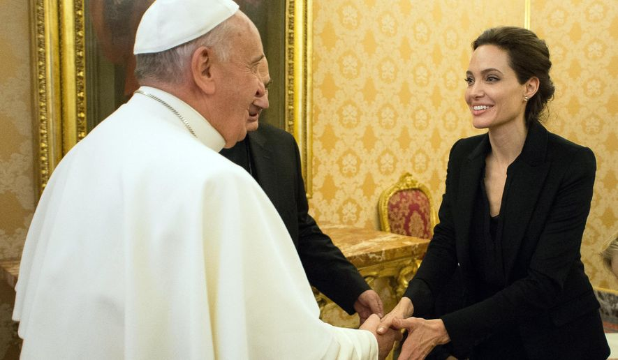 Pope Francis meets Angelina Jolie during a private audience at the Vatican, Thursday, Jan. 8, 2015. (AP Photo/L'Osservatore Romano, Pool)