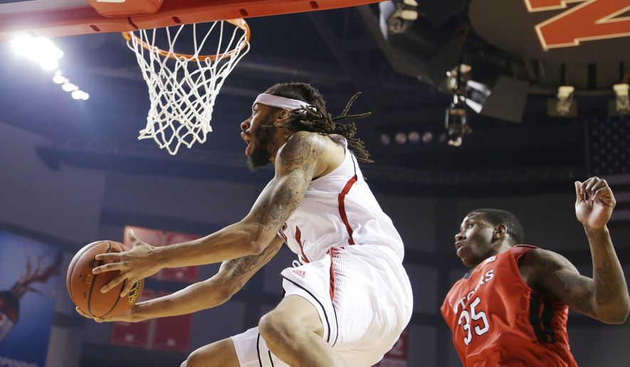 Nebraska's Terran Petteway (5) goes for a layup against Rutgers' Greg Lewis (35) during the first half of an NCAA college basketball game in Lincoln, Neb., Thursday, Jan. 8, 2015. (AP Photo/Nati Harnik)
