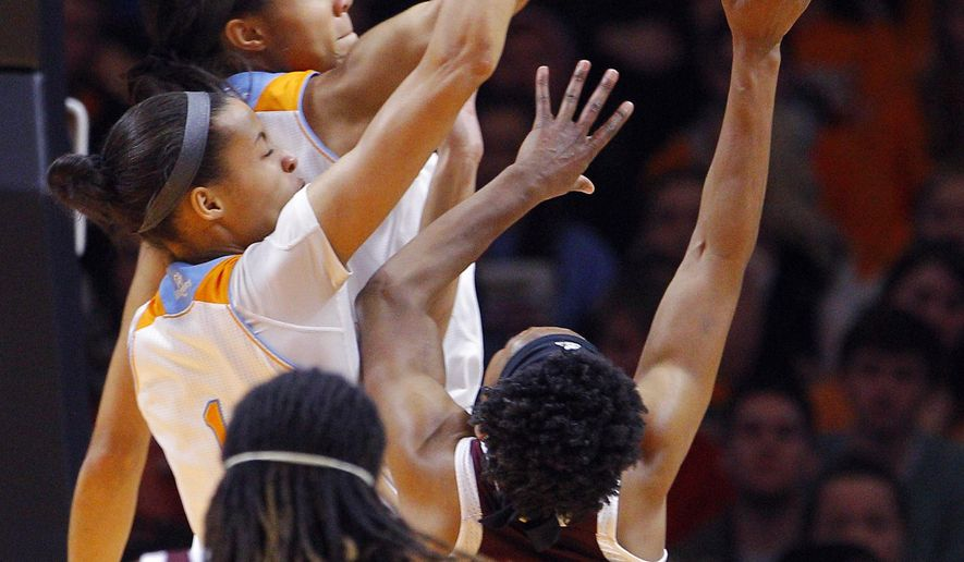Tennessee center Isabelle Harrison, behind, and Nia Moore (1) attempt to block the shot of Texas A&M guard Courtney Walker (33) in the first half of an NCAA college basketball game Thursday, Jan. 8, 2015, in Knoxville, Tenn. (AP Photo/Wade Payne)