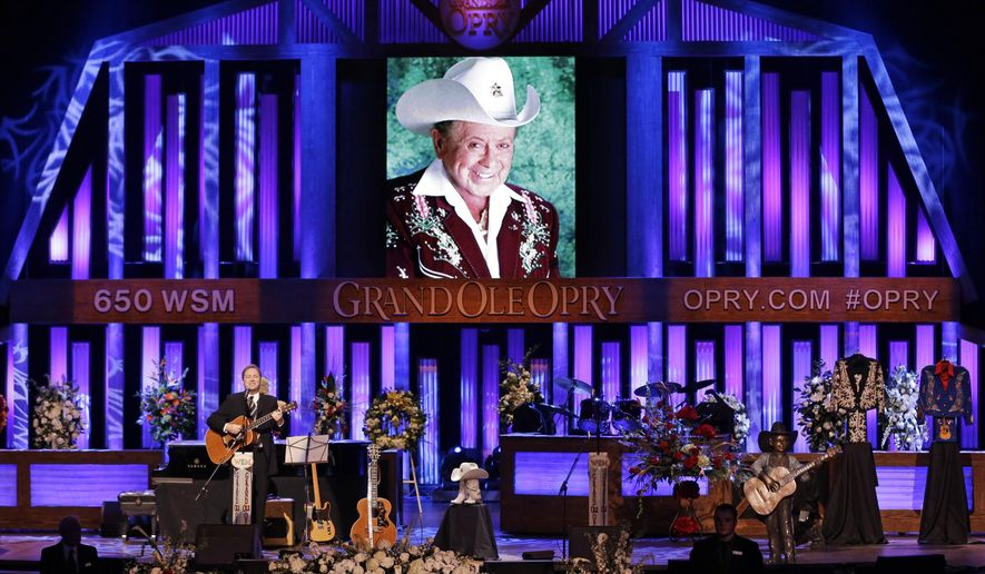 Steve Wariner performs during the funeral service for Little Jimmy Dickens in the Grand Ole Opry House Thursday, Jan. 8, 2015, in Nashville, Tenn. Dickens died Jan. 2, 2015, at the age of 94. (AP Photo/Mark Humphrey)