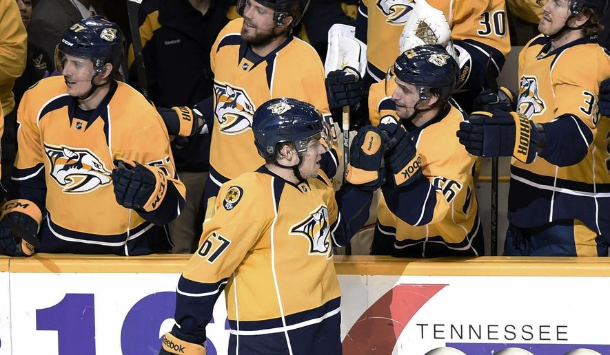 In his first NHL game Nashville Predators forward Miikka Salomaki (67), of Finland, celebrates his first goal against the Dallas Stars in the second period of an NHL hockey game Thursday, Jan. 8, 2015, in Nashville, Tenn. (AP Photo/Sanford Myers)