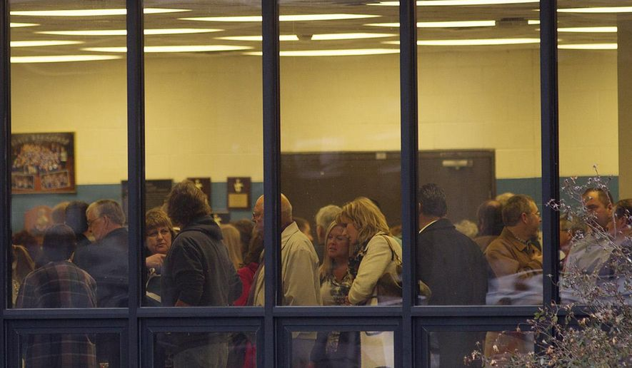 People line up at Nashville Middle School in Nashville, Ill. on Thursday, Jan. 8, 2015 to pay their respects to the Gutzler family. Nine-year-old Piper Gutzler and her parents, Marty, 48, and Kim, 49, were killed along with 14-year-old relative Sierra Wilder when the small plane piloted by Marty crashed on Jan. 2. The family was returning from a Florida vacation. (AP Photo/Bellville News-Democrat, Zia Nizami)
