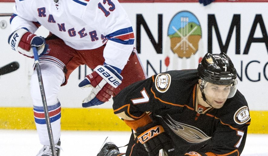The Ducks' Andrew Cogliano controls the puck as he falls to the ground during a game in Los Angeles on Wednesday night Jan. 7, 2014. (AP Photo/The Orange County Register, Kyusung Gong)