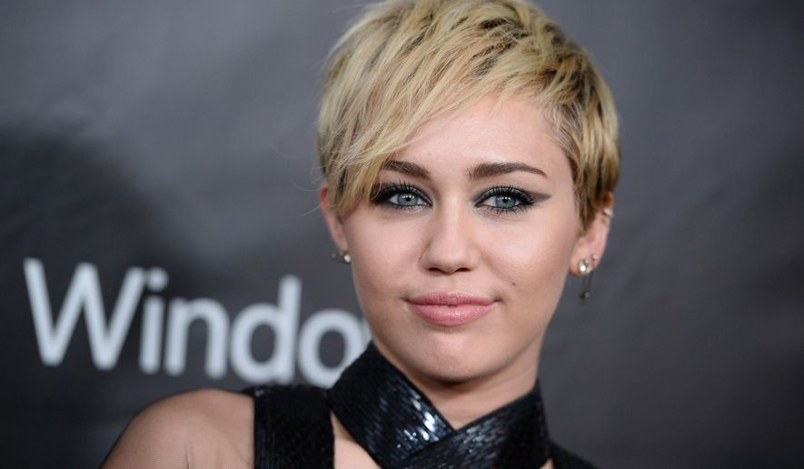 FILE - In this Oct. 29, 2014 file photo, Miley Cyrus arrives at the 2014 amfAR Inspiration Gala at Milk Studios in Los Angeles. A convicted burglar charged with breaking into the Los Angeles home of Cyrus has pleaded not guilty to felony charges. Rusty Sellner entered pleas Thursday, Jan. 8, 2015, to burglary, receiving stolen property and grand theft. He could face seven years and eight months in prison if convicted. (Photo by Jordan Strauss/Invision/AP, File)