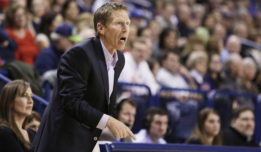 Gonzaga coach Mark Few talks to his team during the first half of an NCAA college basketball game against San Francisco in Spokane, Wash., Thursday, Jan. 8, 2015. (AP Photo/Young Kwak)