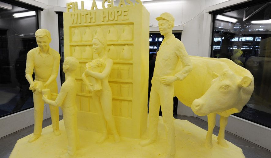 The Pennsylvania Farm Show Butter Sculpture is unveiled during a ceremony at the Farm Show complex Thursday, Jan. 8, 2015,  in Harrisburg, Pa. (AP Photo/Bradley C Bower)