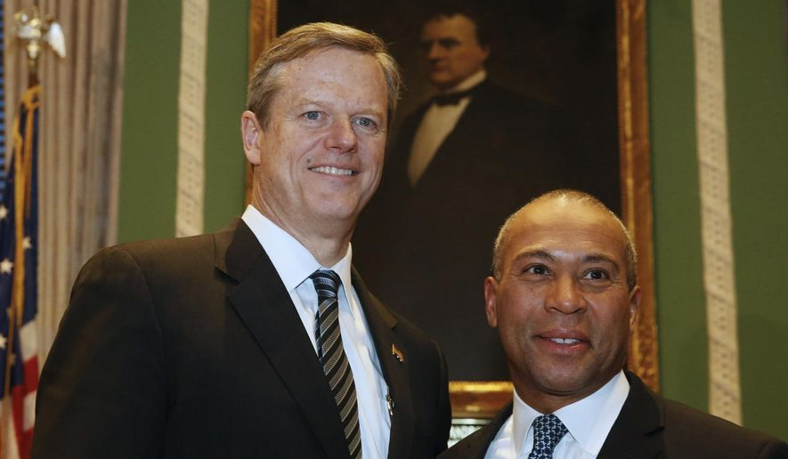 Governor-elect Charlie Baker, left, poses for a photo with Gov. Deval Patrick in the Governor's Office at the State House, in Boston, Wednesday, Jan. 7, 2015. Patrick left the Massachusetts Statehouse for the last time as governor Wednesday.  (AP Photo/The Boston Herald, Angela Rowlings, Pool )