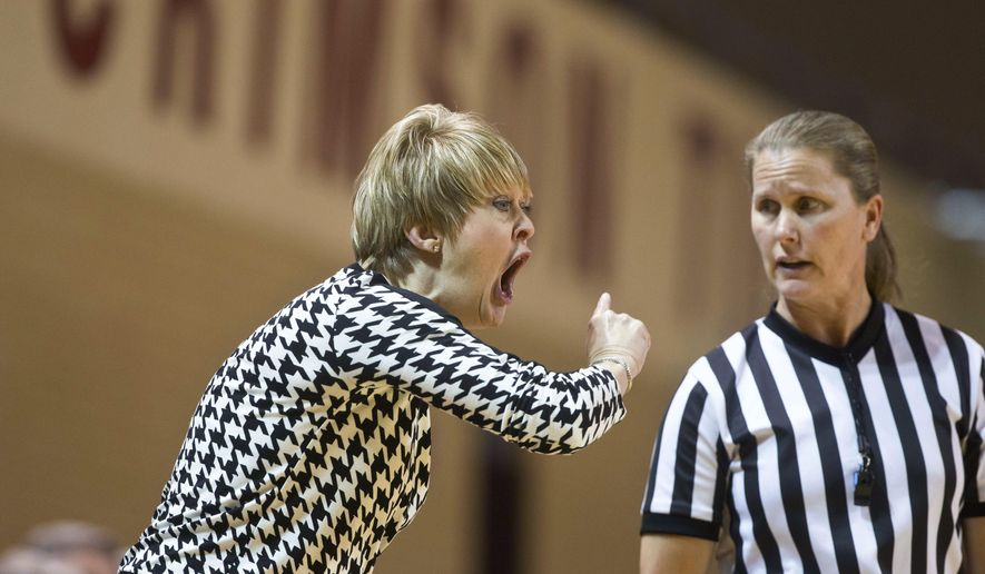 Alabama coach Kristy Curry yells in disagreement with a foul called by a referee, during the first half of an NCAA college basketball game against South Carolina, Thursday, Jan. 8, 2015, in Tuscaloosa, Ala. (AP Photo/Brynn Anderson)