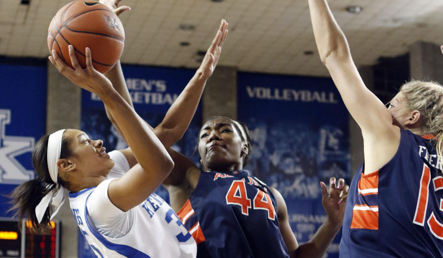Kentucky's Alexis Jennings, left, shoots under pressure from Auburn's Tra'Cee Tanner (44) and Katie Frerking (13) during the second half of an NCAA college basketball game in Lexington, Ky., Thursday, Jan. 8, 2015. Kentucky won 78-57. (AP Photo/James Crisp)