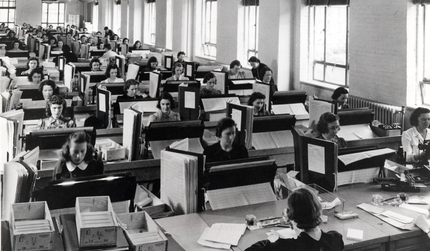 In this photo provided by the U.S. Census Bureau, tabulators in Washington record the information from the more than 120,000 enumerators who gathered data for the 1940 U.S. Census. The days of the census taker with a clipboard in hand may be numbered. Instead, the U.S. Census Bureau is testing digital means of counting Americans this year, from asking people to fill out their forms on the Internet instead of through the mail to giving their employees smartphones instead of paper to complete their counts. (AP Photo/National Archives and Records Administration)