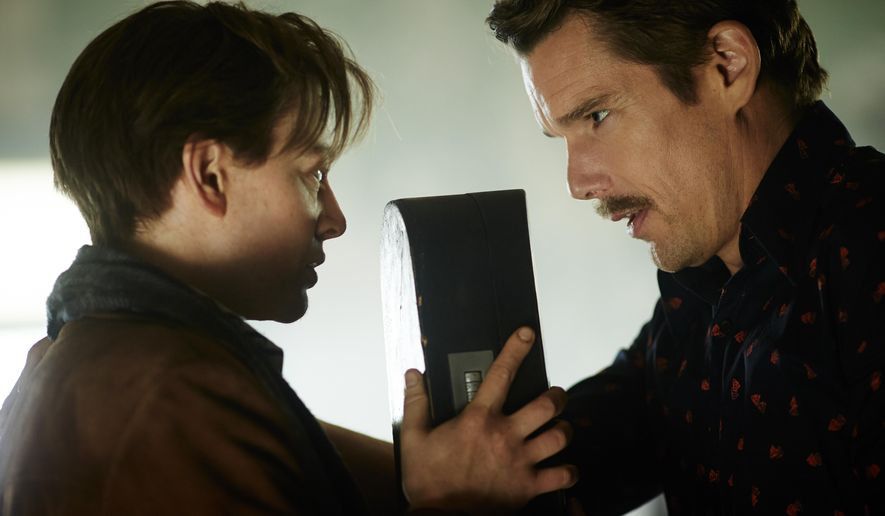 "In this image released by Sony Pictures Worldwide Acquisitions, Sarah Snook, Left, and Ethan Hawke appear in a scene from the film, ""Predestination."" (AP Photo/Sony Pictures Worldwide Acquisitions, Ben King)"