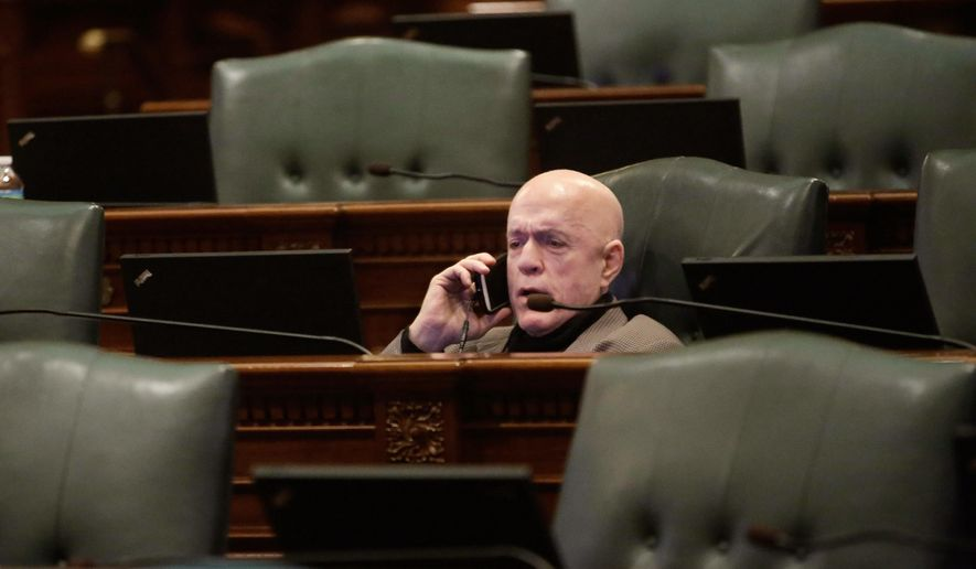 Illinois Rep. Greg Harris, D-Chicago, is surround by empty seats while on the House floor waiting for a special session to begin at the Illinois State Capitol Thursday, Jan. 8, 2015, in Springfield Ill. Lawmakers decide whether to approve a special election in 2016 that could cut in half Gov.-elect Bruce Rauner's appointment of a replacement for late comptroller Judy Baar Topinka. (AP Photo/Seth Perlman)